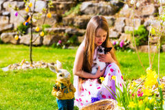 Girl on Easter egg hunt with living Easter Bunny Royalty Free Stock Images