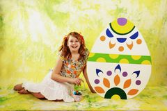 Girl and easter eggs Stock Images
