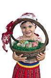 Girl with easter eggs in a basket. Young girl dressed in traditional clothing with easter eggs in a basket over white background royalty free stock image