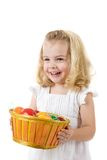 Girl with easter eggs in a basket Royalty Free Stock Photography