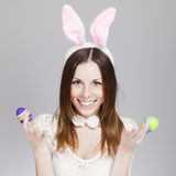 Girl with easter eggs. Brunette smiling and holding painted easter eggs Royalty Free Stock Images