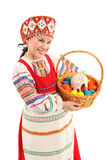 Girl with Easter eggs and a holiday cake Royalty Free Stock Photography