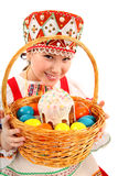 Girl with Easter eggs and a holiday cake Stock Image