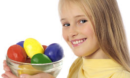 Girl with easter eggs smiling Stock Photos
