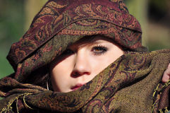 Girl with eastern headscarf. Face of a teen girl with headscarf Royalty Free Stock Photos
