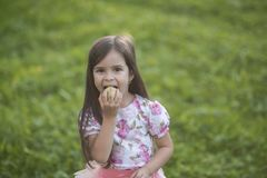 Girl eat apple on natural background, vitamin Stock Images