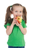 Girl eat apple on white Royalty Free Stock Photography