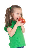 Girl eat apple on white Royalty Free Stock Images