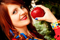 Girl eat an apple royalty free stock images