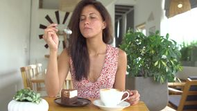 Girl eat cake and drink coffee stock video footage
