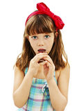 Girl eat chocolate Royalty Free Stock Photos