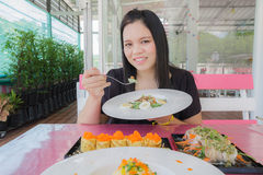 Girl eat food in restaurant Royalty Free Stock Photos