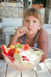 Girl eat fruit salad Royalty Free Stock Photography