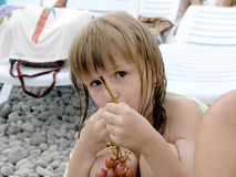 Girl eat the grape Royalty Free Stock Photography