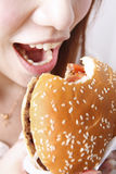 Girl  eat a hamburger Royalty Free Stock Photo