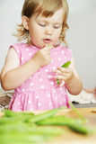 Girl eat peas Stock Photos