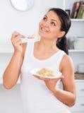 Girl eat porridge Stock Photography