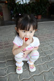 Girl eat strawberry. Cutie girl enjoys her strawberry at Cameron highland Stock Photo