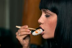 The girl eat sushi Stock Photography