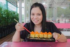 Girl eat Sushi Stock Image