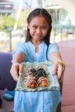 Girl eat takoyaki Stock Images