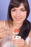 Girl eat yogurt. Happy girl and yogurt with strawberry stock images