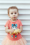 Girl eaten corn on the cob make dirty, soiled Royalty Free Stock Images