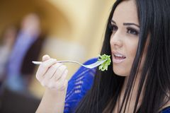 Girl eating Royalty Free Stock Photos