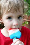 Girl Eating A Popsicle Stock Images