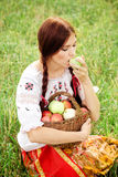 Girl eating an apple Stock Photography