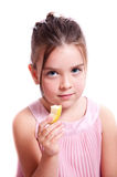Girl eating an apple. stock photo