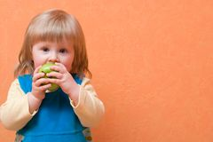 Girl eating apple Royalty Free Stock Photos