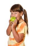 Girl eating apple Stock Image