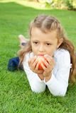 Girl eating an apple Royalty Free Stock Photo