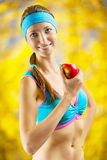 A girl eating an apple Stock Image