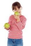 Girl eating an apple Royalty Free Stock Image
