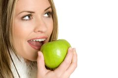 Girl Eating Apple. Beautiful healthy girl eating apple Royalty Free Stock Image