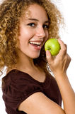 Girl Eating Apple. A pretty young woman holding an apple she's about to eat Stock Images