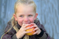 Girl eating apple Royalty Free Stock Image