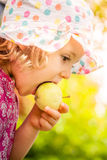 Girl eating an apple Stock Photos