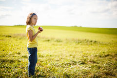 Girl eating an apple Stock Images