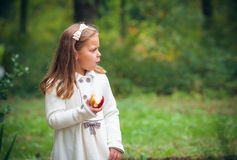 Girl is eating apple outdoor Royalty Free Stock Photos