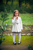 Girl is eating apple outdoor Royalty Free Stock Images