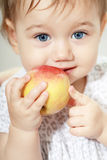 Girl eating apple Stock Photography