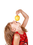 Girl eating an apple. Stock Photos
