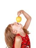 Girl eating an apple. Stock Photos