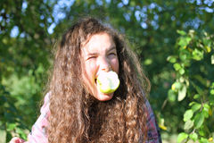 Girl eating apples Stock Photos