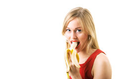 Girl eating banana Royalty Free Stock Images