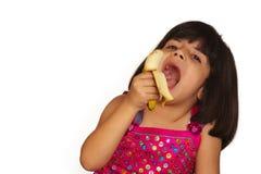 Girl eating banana Royalty Free Stock Images