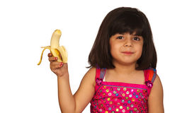 Girl eating banana. Portrait of a sweet young girl eating banana isolated on white background stock photo